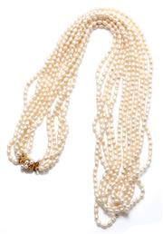 Sale 9020 - Lot 316 - A MULTISTRAND FRESHWATER PEARL NECKLACE; 6 strands of 4 x 5.9mm baroque cultured pearls to a silver gilt clasp, length 85cm.