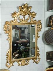 Sale 9087H - Lot 75 - A finely carved antique Italian giltwood wall mirror. Overall approx.. 152 x 106 cm