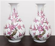 Sale 8338A - Lot 81 - A pair of Chinese yuhuchunping shaped vases, with cherry blossom design, H 53cm