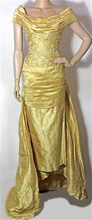 Sale 8173F - Lot 359 - A GOLDEN RAW SILK AND LACE DEBUTANTE GOWN; off the shoulder, button down back with bustle train (8), no label.