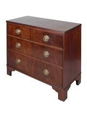 Sale 8379A - Lot 16 - Georgian Mahogany Chest of Drawers  The rectangular top with reeded edge above two short and two long drawers with brass handles...