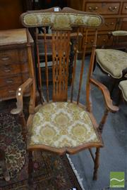 Sale 8460 - Lot 1096 - Edwardian Maple Highback Spindle Armchair, with padded back & seat, raise don turned legs with stretchers