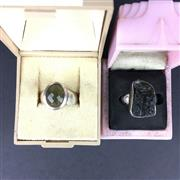 Sale 8567 - Lot 860 - Moldavite & 925 Silver Rings (2, one faceted, one natural)