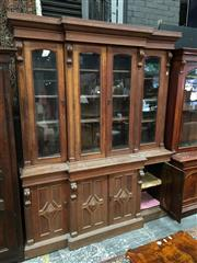 Sale 8882 - Lot 1061 - Victorian Oak Breakfront Bookcase, with four slightly arched glass panel doors & diamond panel doors below (key in office)