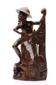 Sale 9070 - Lot 88 - A Carved Timber Figure of A Fisherman (H 41cm)
