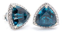 Sale 9132 - Lot 439 - A PAIR OF 18CT WHITE GOLD TOPAZ AND DIAMOND EARRINGS; each a cluster centring a trillion cut London blue topaz surrounded by round b...