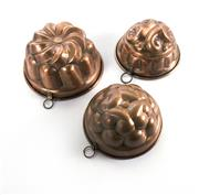 Sale 8224A - Lot 20 - A set of three old French copper jelly / aspic moulds, 15, 17 and 18 cm  dia.