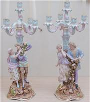 Sale 8430 - Lot 32 - A pair of C19th Sitzendorf figural candelabra in the Meissen style, each with five sconces and modelled with a couple
