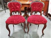 Sale 8848 - Lot 1015 - Interesting Set of Four Victorian Carved Walnut Chairs, with buttoned back and seat upholstered in red cut-moquette velvet