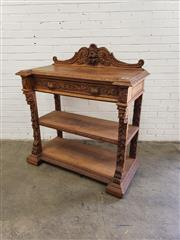 Sale 9085 - Lot 1076 - Late 19th Century Flemish Carved Oak Dumbwaiter, with low fruit carved back, the frieze drawer with leaf handles, having carved fasc...