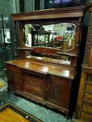 Sale 8653 - Lot 1018 - Edwardian Carved Walnut Breakfront Sideboard, with high shaped mirror back supported by columns, above two drawers & fall-front flan...
