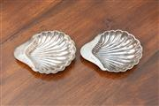 Sale 8838H - Lot 36 - A pair of Sheffield sterling silver shell form butter dishes, marked RMEH, 1911. Length 13.5cm. Total weight 140 grams.