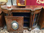 Sale 8882 - Lot 1012 - Victorian Figured Walnut Breakfront Credenza, with gilt brass mounts & Sevres style figural porcelain panel to the central door, fla...