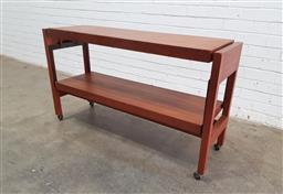 Sale 9134 - Lot 1046 - Metamorphic Teak hall table/open bookcase converts to dining table  (h:74 x w:127 x d:38cm)