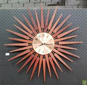 Sale 8607 - Lot 1006 - Teak Sunburst Wall Clock