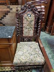 Sale 8634 - Lot 1096 - 19th Century French Oak Chair, with barley twist supports & gryphon style figures, upholstered in floral upholstery & conforming legs