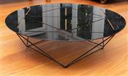 Sale 8694A - Lot 3 - A contemporary black lacquered metal based coffee table with geometric laser cut design circular top H x 60cm, diam x 90cm