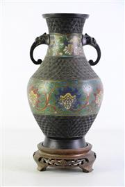 Sale 8952 - Lot 1 - A twin handled cloisonne inserted vase on timber stand (total height 31.5cm)