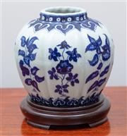 Sale 9005H - Lot 41 - A Thickly potted and glazed Chinese blue and white lobed shouldered vase with floral motif on timber stand, Height 14cm