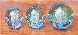 Sale 9099 - Lot 251 - A set of three graduating paperweights in aqua, largest Height 7cm