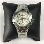 Sale 8283B - Lot 70 - A SEIKO CHRONOGRAPH TACHYMETER WRISTWATCH, with three subsidiary dials and date aperture on steel band, new in box, needs battery.