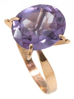 Sale 9149 - Lot 367 - A 9CT GOLD STONE SET COCKTAIL RING; claw set with a 14 x 12mm oval cut synthetic colour change sapphire to imitate alexandrite, 1 cl...