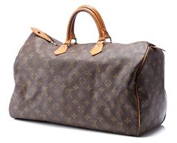 Sale 9186 - Lot 341 - A VINTAGE LOUIS VUITTON MONOGRAM SPEEDY 40;  monogram canvas with tan leather trim and top handles to gold tone hardwarware zipper o...