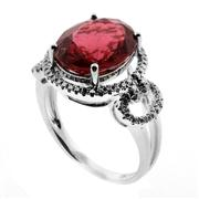 Sale 8050B - Lot 84 - AN 18CT WHITE GOLD TOURMALINE AND DIAMOND RING; 11.5 x 9.5 brownish pink tourmaline to surround and shoulders set with round brilliant.