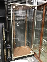 Sale 9014 - Lot 1015 - 1920s Tall Chromed Frame Shop Display Cabinet, with door to back, raised on paw feet, with later down-light wiring (wiring needs che...