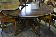 Sale 8093 - Lot 1561 - Circular Table on Carved Quadraform base (062125)