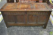Sale 8359 - Lot 1030 - 17th Century Panelled Oak Coffer with hinged lid & chip carved frieze