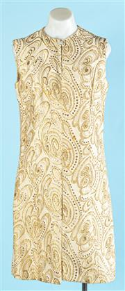 Sale 9090F - Lot 106 - A DIANA RICHARDS LONG VEST, with diamante clasp to neck embroided with gold patterns size S
