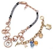 Sale 9083 - Lot 578 - MIMCO NECKLACE AND MISSONI CHARM BRACELET; Mimco rose gold tone ring form necklace to marcasite set silver tone rings on black and w...