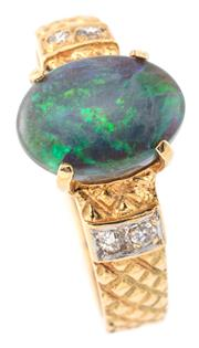 Sale 9095 - Lot 346 - AN 18CT GOLD OPAL AND DIAMOND RING; centring a 9.6 x 7mm oval cabochon black opal (approx. 1.40ct) to guilloche shoulders set with 4...