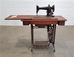 Sale 9166 - Lot 1022 - Treadle based sewing machine by Singer