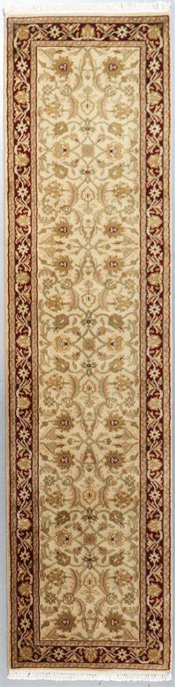 Sale 9181C - Lot 9 - A finely woven Jaipur wool runner in saffron and rust tones 310 x 70cm