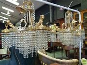 Sale 8559 - Lot 1092 - Pair of Gilt Brass Chandeliers, modelled with cherubs holding pendant lights & crystal drops