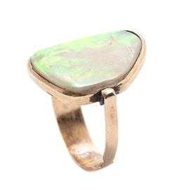 Sale 9253J - Lot 498 - A 9CT GOLD OPAL RING; featuring a 22 x 15mm freeform solid white opal plaque with good green, yellow, red flash, glued into handmade...