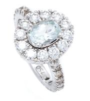 Sale 8928 - Lot 367 - AN 18CT WHITE GOLD AQUAMARINE AND DIAMOND CLUSTER RING; centring an approx. 0.70ct aquamarine to surround and shoulders set with 30...