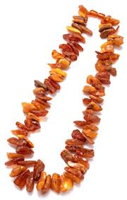 Sale 9083 - Lot 548 - A VINTAGE AMBER NECKLACE; 18-29mm amber pieces in honey and butterscotch colours (crazed) to screw barrel clasp, length 63cm.