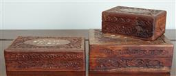 Sale 9103M - Lot 533 - A group of three graduating carved timber trinket boxes with inlaid tops, largest Height 7.5cm x Width 20cm x Depth 15cm