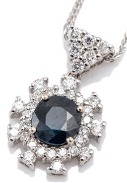 Sale 9132 - Lot 529 - AN 18CT WHITE GOLD SAPPHIRE AND DIAMOND PENDANT NECKLACE; starburst cluster centring an oval cut 1.26ct blue sapphire (wear, chip) t...