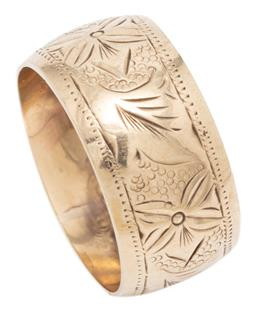 Sale 9209J - Lot 315 - A 9CT GOLD BAND; 9.5mm wide rounded band with floral engraving, size O, wt. 3.03g.