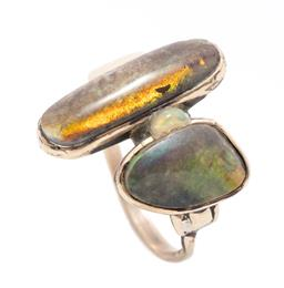 Sale 9253J - Lot 496 - A 9CT GOLD OPAL RING; collet set with 2 oval and freeform treated opals glued into setting with a solid crystal opal on hand made se...