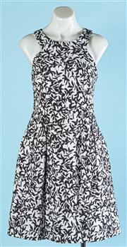 Sale 9090F - Lot 180 - A CUE SLEEVELESS DRESS, in black and white with pleated skirt and zip up back, size 8