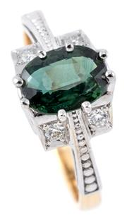 Sale 9095 - Lot 332 - AN 18CT GOLD SAPPHIRE AND DIAMOND RING; rhodium plated top centring a green oval cut sapphire of approx. 1ct between upswept shoulde...