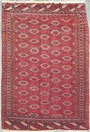 Sale 8882 - Lot 1015 - Possibly Turkoman Beshir Wool Carpet, with off-set medallion, in red, black & white (330 x 206cm)