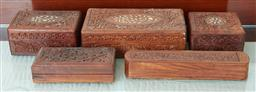 Sale 9103M - Lot 535 - A group of carved timber boxes with floral motif, including three with inlaid top, and two others.