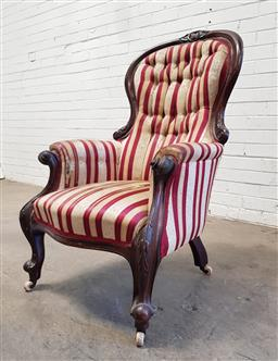 Sale 9126 - Lot 1141 - Victorian Carved Mahogany Gentlemans Armchair, with red striped & buttoned upholstery, raised on cabriole legs (h:110 x w:65 x d:67cm)