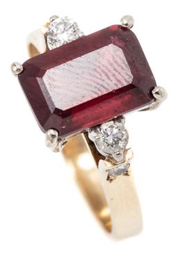 Sale 9253J - Lot 381 - A RUBY AND DIAMOND RING; claw set with a step cut glass treated ruby flanked by 2 round brilliant cut diamonds to upswept shoulders...
